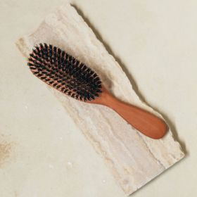 A front view of the boars hairbrush with wild boar bristles and pear wood.