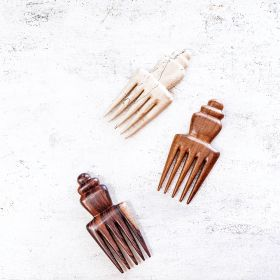 the nipa hair comb in teak, tamarind and rosewood close up aerial view on a table