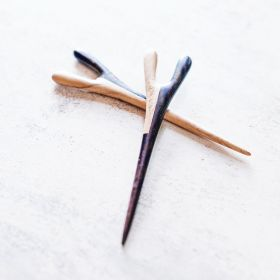 The taro hair stick in tamarind and rosewood aerial view on a table