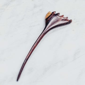 A Champaka Hair stick in Rosewood.