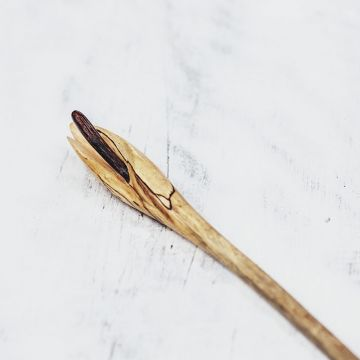 Front view of a Frangipani Hair stick in Tamarind.