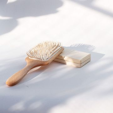 Front view of the beech wood paddle hairbrush with wooden pins.