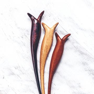 soka-bud-hairstick-teak-tamarind-rosewood-table-view